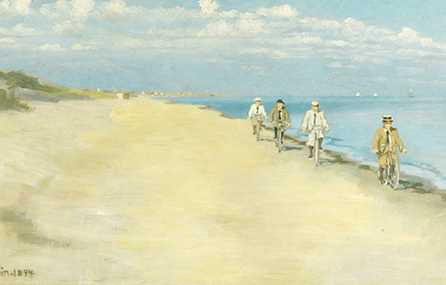 Four men on cycles by the beach